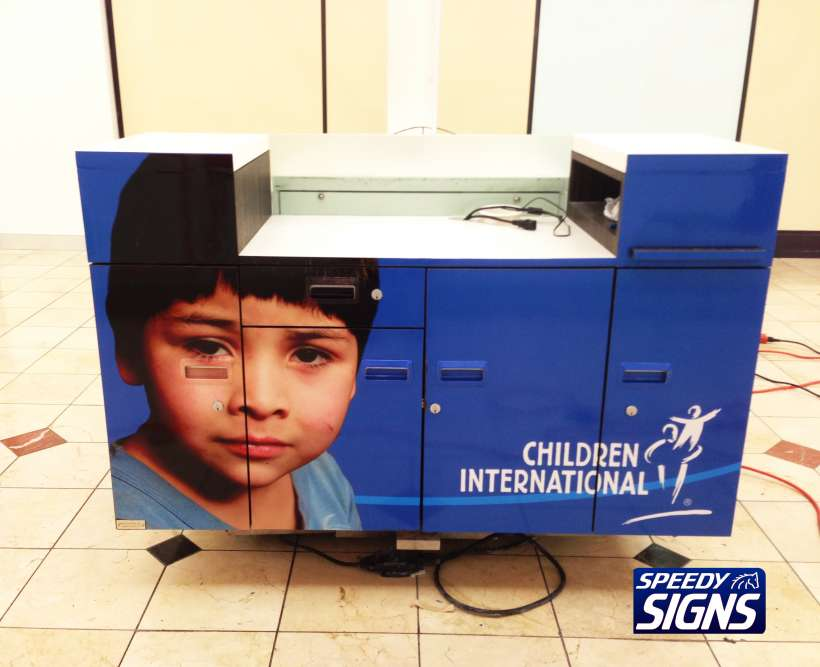 Children-International-Kiosk-Wrap-2-with-LOGO.jpg